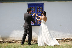 Bride and groom at the window Royalty Free Stock Image