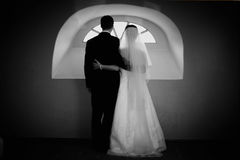 Bride and groom at window. Bride and groom standing at the window Stock Image