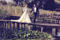 Bride and groom on wooden bridge Royalty Free Stock Image
