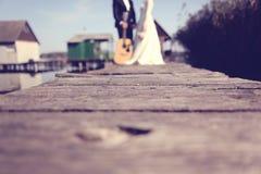 Bride and groom on wooden bridge Stock Photo