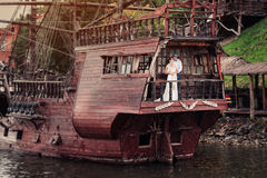 The bride and groom on a wooden ship Stock Photos