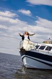 Bride and groom on a  yacht Stock Photo