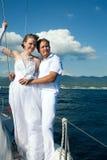 Bride and groom on a yacht Stock Photos