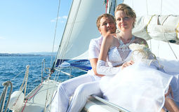 Bride and groom on a yacht stock photos