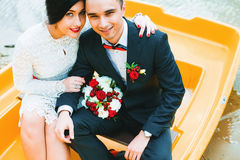 Bride and groom in yellow boat Stock Image