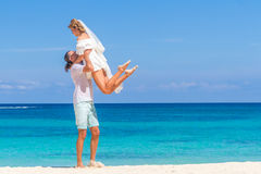 Bride and groom, young loving couple, on their wedding day, outd. Oor beach wedding on tropical beach and sea background Royalty Free Stock Photography