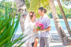 Bride and groom, young loving couple, on their wedding day, outd Royalty Free Stock Photography
