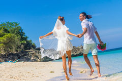 Bride and groom, young loving couple, on their wedding day, outd Royalty Free Stock Image