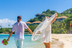 Bride and groom, young loving couple, on their wedding day, outd. Oor beach wedding on tropical beach and sea background Royalty Free Stock Images