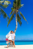 Bride and groom, young loving couple, on their wedding day, outd. Oor beach wedding on tropical beach and sea background Stock Photos