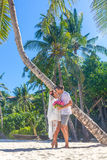 Bride and groom, young loving couple, on their wedding day, outd. Oor beach wedding on tropical beach and sea background Royalty Free Stock Image