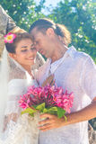 Bride and groom, young loving couple, on their wedding day, outd Stock Image