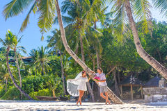 Bride and groom, young loving couple, on their wedding day, outd. Oor beach wedding on tropical beach and sea background Stock Photography