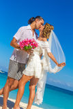 Bride and groom, young loving couple, on their wedding day, outd Royalty Free Stock Photo