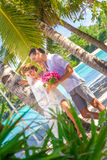 Bride and groom, young loving couple, on their wedding day, outd. Oor beach wedding on tropical beach and sea background Royalty Free Stock Photo