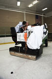 Bride and Groom on Zamboni. A just married bride and groom riding on a Zamboni in an ice rink stock photos