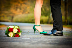 Bride on grooms feet Stock Images