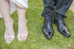 Bride and grooms feet at a wedding Royalty Free Stock Photo