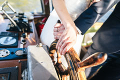 Bride and Grooms Hand and on a Steering Wheel Royalty Free Stock Photos