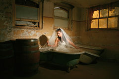 Bride in a Grungy Bathtub Royalty Free Stock Image