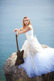 Bride with guitar Royalty Free Stock Photo