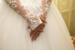 Bride had folded her hands in front of him. The bride had folded her hands in front of him Stock Images