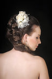 Bride with hair and a flower in her hair Royalty Free Stock Image