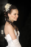 Bride with hair and a flower in her hair Stock Photos