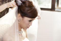 Bride hairdo. Asian bride having hairdo on her wedding day Royalty Free Stock Images