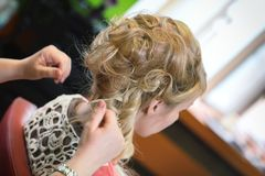 Bride at the hairdresser Stock Images