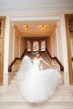 Bride in hall with staircase Stock Photo