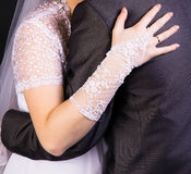 Bride hand on the back of the groom. Gentle loving hug Royalty Free Stock Images