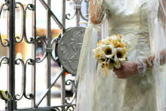 Bride with Hand Flower. Bride holds a hand flower royalty free stock image
