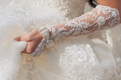 Bride hand with lace decoration Stock Photography