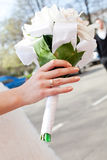Bride hand with ring and wedding bouquet Stock Photography