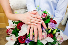 Bride hand with ring and wedding bouquet Stock Image