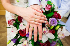 Bride hand with ring and wedding bouquet Stock Images