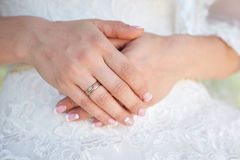 Bride hand with a wedding ring on the background of dress Royalty Free Stock Photo