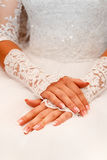 Bride hand on white dress. Closeup Royalty Free Stock Image