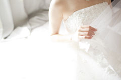 Bride hand on white dress Royalty Free Stock Photos