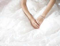 Bride hand on white dress Stock Photo
