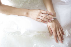 Bride hand on white dress Stock Image