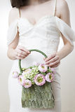 Bride with handbag in her hand Stock Image