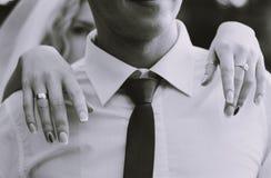 Bride hands on groom shoulders stock photos