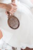 Bride hands on her wedding dress. Stock Image