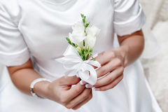 Bride hands holding beautiful wedding bouquet Royalty Free Stock Images