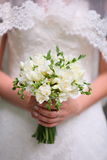 Bride hands holding beautiful wedding bouquet. Closeup of bride hands holding beautiful wedding bouquet Stock Photography