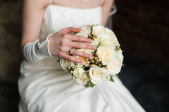 Bride hands holding beautiful wedding bouquet Royalty Free Stock Photos