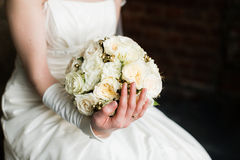 Bride hands holding beautiful wedding bouquet Stock Photography