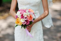 Bride hands holding bouquet Royalty Free Stock Image